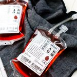 This Blood Bag Cocktail is the perfect quick drink for all your Halloween parties! Made with two ingredients, this drink is an easy and deliciously spooky libation!