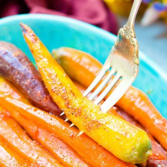 These Orange Braised Carrots are bound to be a highlight on your dinner table! Made with fresh-squeezed orange juice, butter, shallots, black pepper, and turmeric, this is one delicious side dish recipe!