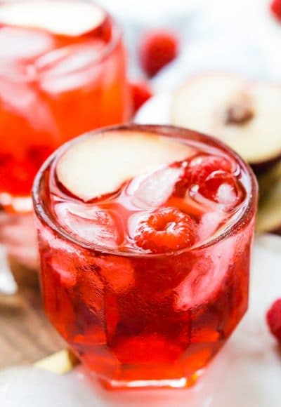 A Red Russian Cocktail is made with equal parts cherry liqueur and vodka over ice. Serve it up in a punch bowl for parties or serve it in short glasses for individual cocktails.