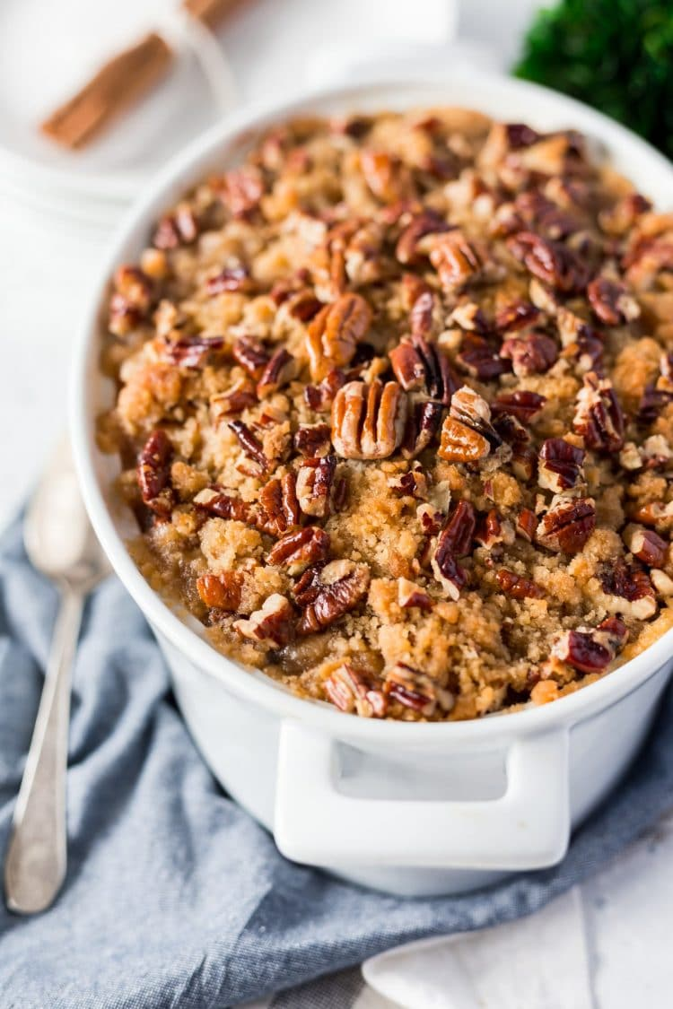 This Sweet Potato Casserole is loaded with rich and cozy flavors of brown sugar, cinnamon, and nutmeg. It's laced with butter and crunchy pecans, the perfect holiday side dish!