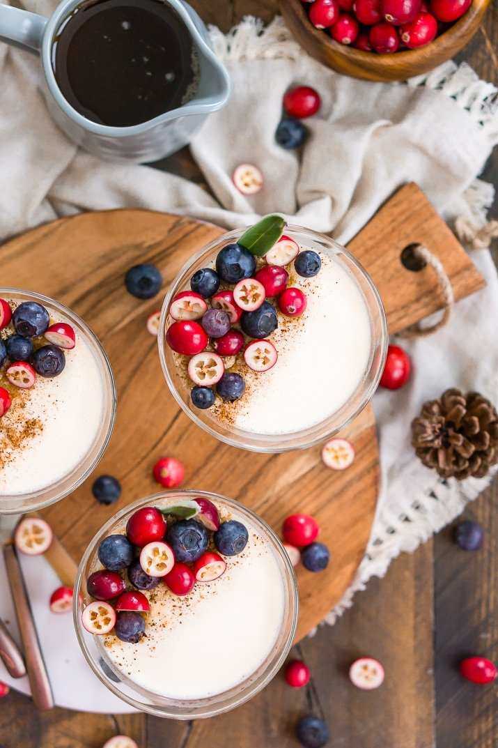 Maple Panna Cotta topped with brown sugar, nutmeg, blueberries, and cranberries