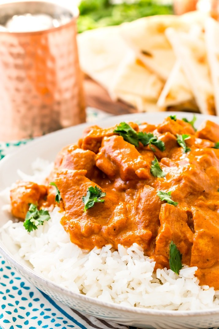 This Easy Chicken Tikka Masala Recipe is a delicious British Indian recipe made with a rich and creamy tomato curry sauce loaded with bold spices and chicken.