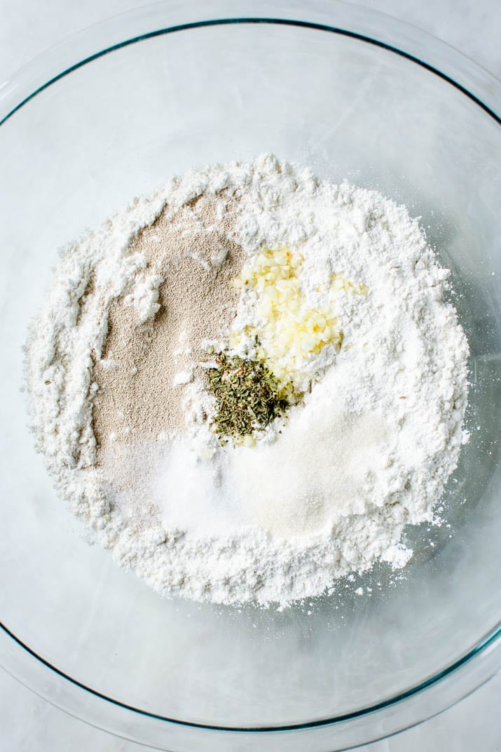 Preparing flour mixture for garlic parmesan breadsticks
