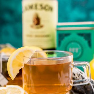 This Hot Toddy recipe is a cold remedy you can mix up at home with simple ingredients that will soothe a sore throat, reduce congestion, and aid sleep. A mixed drink recipe made with lemon, honey, whiskey, and tea.