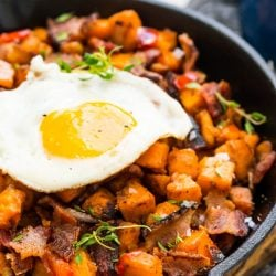 This Sweet Potato Hash is loaded with onions, peppers, bacon, and seasonings and topped with eggs for a delicious and hearty breakfast recipes!
