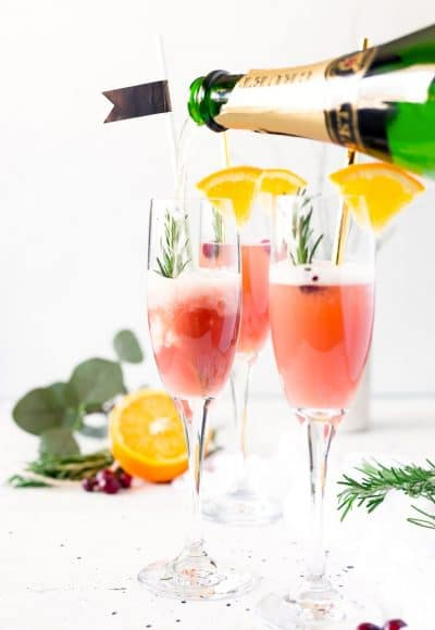 This Cranberry Orange Mimosa is the perfect cocktail for winter brunch! Made with cranberry and orange juice and champagne it's a fruity drink that you canserve up for Christmas or New Year's Eve or any other weekend celebration!