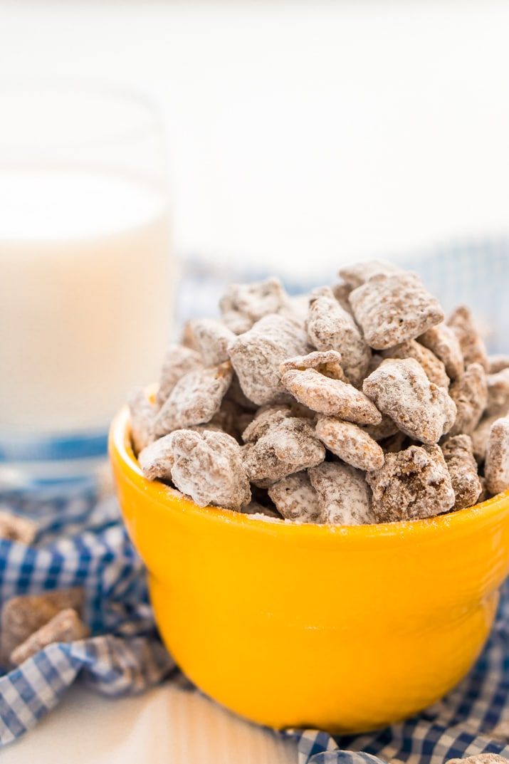This Muddy Buddies or Puppy Chow recipe is an easy and addictive treat perfect for everyday celebrations and the holidays! Loaded with butter, chocolate, peanut butter, and powdered sugar, and ready in just 15 minutes!