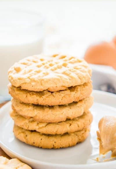 These Peanut Butter Cookies are the classic cookie you all know and love with a secret ingredient that leaves them extra chewy and delicious!