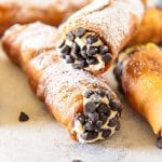 Close up photo of cannoli with chocolate chips.