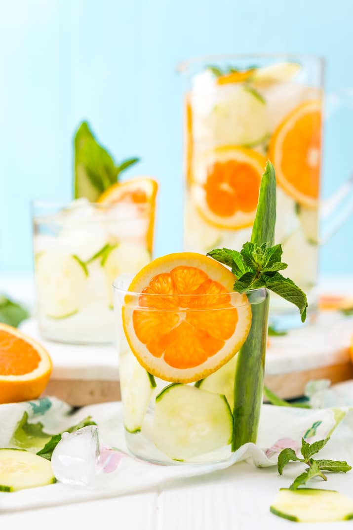 Add mint and oranges to cucumber water for a delicious and refreshing drink!