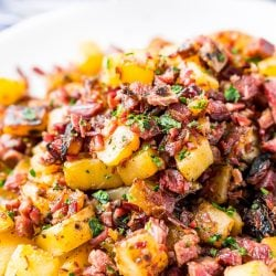 This Corned Beef Hash is a salty and delicious breakfast dish the whole family will love! A simple hash made with brisket, potatoes, onions, butter,thyme, and pepper and a great way to use up leftover Corned Beef!