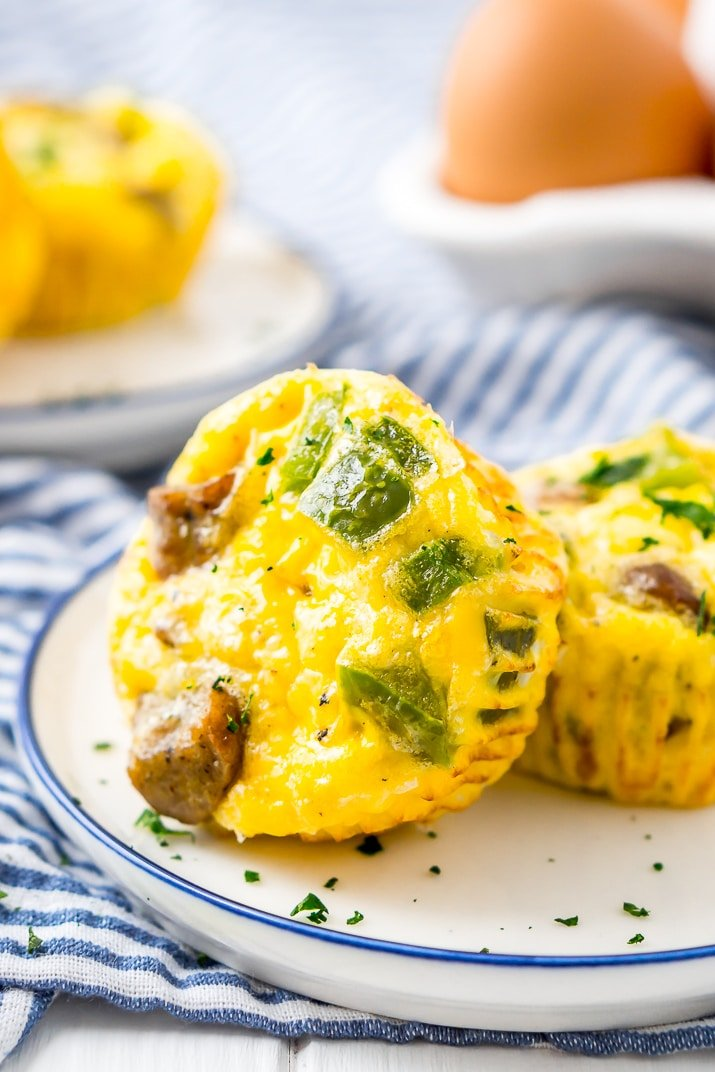 This Crustless Mini Quiche Recipe made with eggs, sausage, green peppers, and cheese are perfect for quick weekday breakfasts or weekend brunch! Make them ahead of time and freeze them for when you want them!