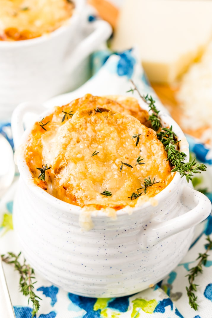 French Onion Soup is a classic dish made with caramelized onions, beef broth, and spices. Topped with crusty French Bread and a layer of melted Gruyère cheese, it's sophisticated enough for a dinner party but comforting enough for a cozy night in!