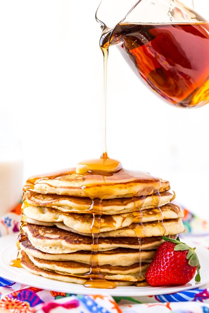 Pouring Maple Syrup on a stack of Homemade Buttermilk Pancakes