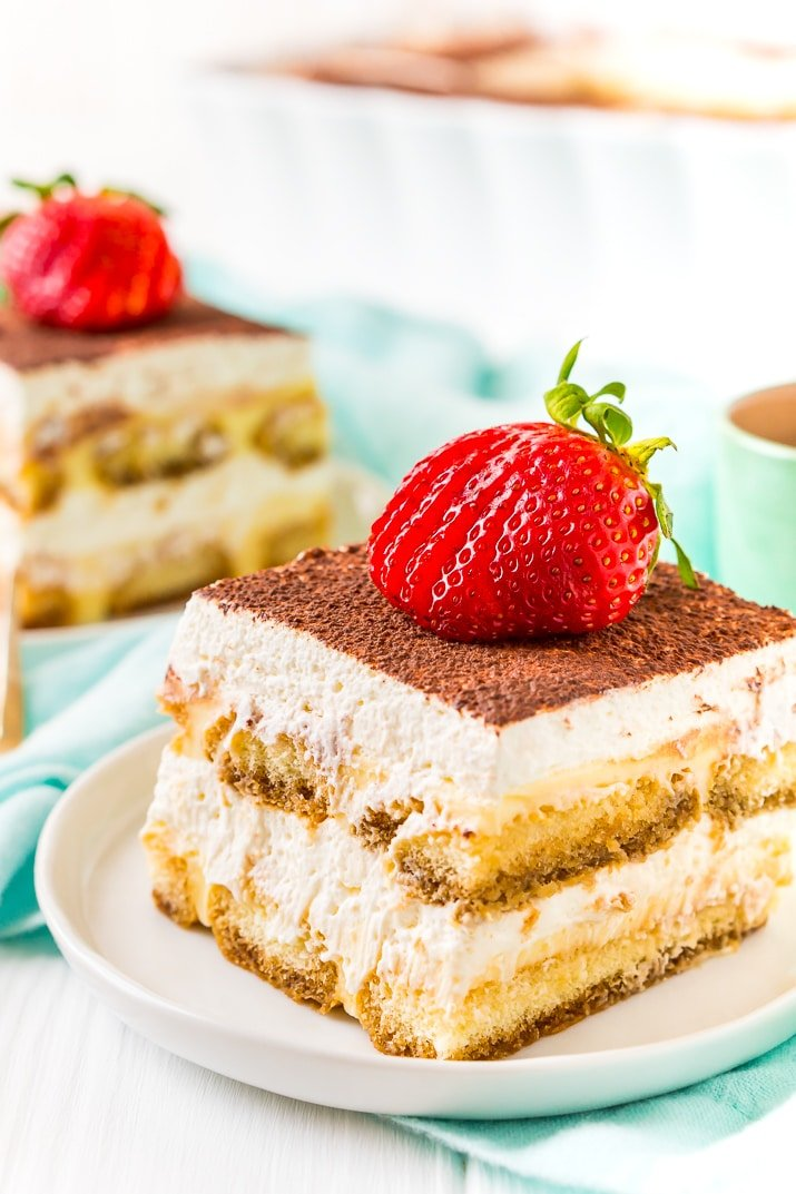 This Boozy Tiramisu recipe swaps out traditional coffee for a rich coffee liqueur. It's a shortcut version made with mascarpone laced pudding instead of a traditional egg custard. Topped with a silky vanilla whipped cream.