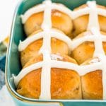 These Hot Cross Buns are a spiced sweet bun loaded with currants or raisins and topped with vanilla icing. They're a traditional Good Friday and Easter recipe!