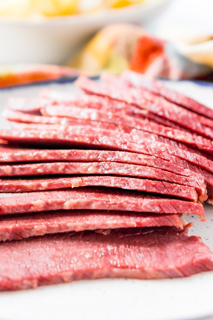 Sliced up corned beef on plate