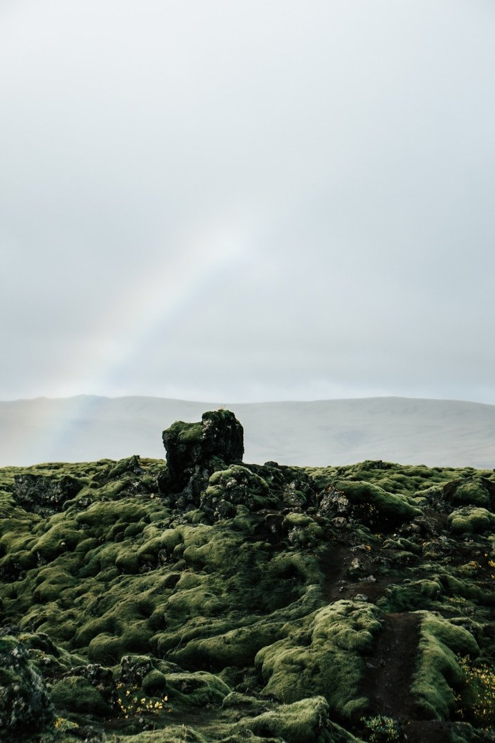 Rainbow over lava field in Iceland