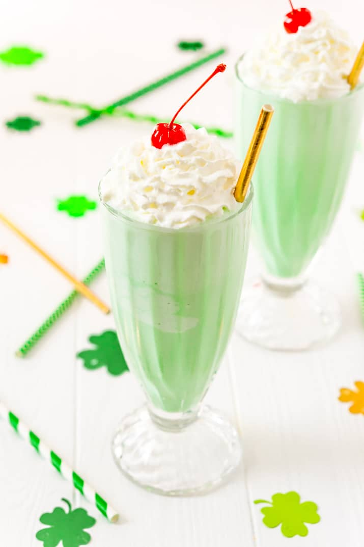 This Shamrock Shake is a McDonald's Copycat recipe that tastes just like the real thing! A thick and sweet vanilla mint shake for St. Patrick's Day!
