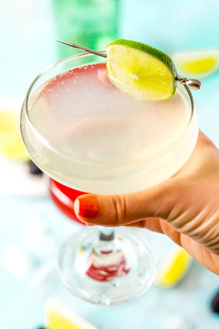 Classic Gimlet cocktail in woman's hand