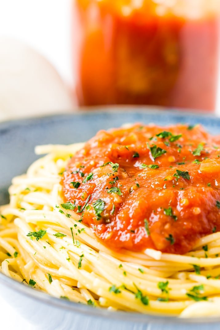 Homemade Pomodoro Sauce on spaghetti in blue bowl