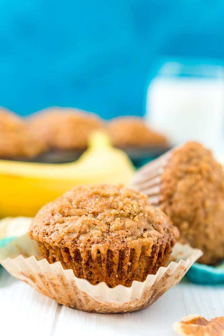 These Banana Muffins are loaded with crunchy walnuts and sweet cinnamon, then topped with a sugary crumble no one can resist!