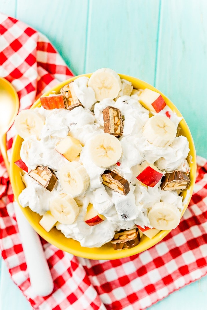This Snickers Salad is an easy and addictive 4-ingredient no-bake dessert salad made with Snickers, banana, apples, and Cool Whip!