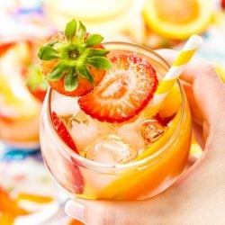 This White Wine Sangria recipe is made with juicy strawberries, oranges, and peaches as well as sweet simple syrup, apricot brandy, and a splash of club soda or seltzer! It's an easy and refreshing summer wine cocktail.