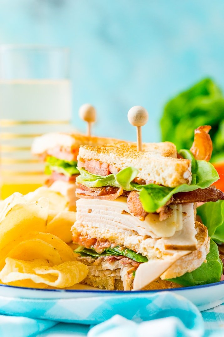 This Club Sandwich Recipe is an easy and classic sandwich made with hickory smoked turkey breast, Swiss cheese, thick-cut bacon, lettuce, tomato, and mayonnaise.