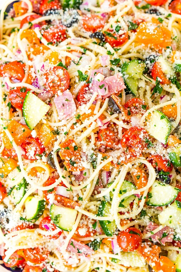 Spaghetti Salad is loaded with veggies, pepperoni, and salami, then tossed in an oil and vinegar dressing. Topped with a sprinkle of parsley and lots of Parmesan cheese, it's a perfect summer meal or side dish!