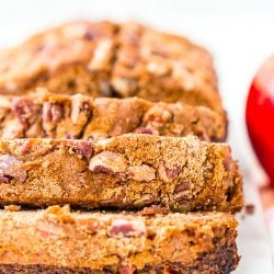 This simple Applesauce Bread is the perfect way to enjoy some of fall's best flavors. Laced with warm spices, brown sugar, and chopped pecans, this quick bread is a delicious treat to make and share during the autumn season.