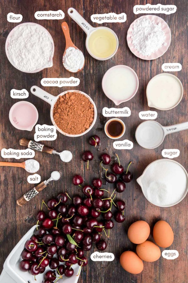 Overhead photo of ingredients to make black forest cake prepped on a wooden counter.