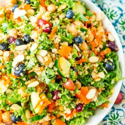 Chopped Kale Salad is loaded with kale, red grapes, orange bell peppers, white quinoa, grated carrots, European cucumbers, Craisins, and sliced almonds. Enjoy it as a wholesome side dish or top with chicken or chickpeas for a light and satisfying meal.