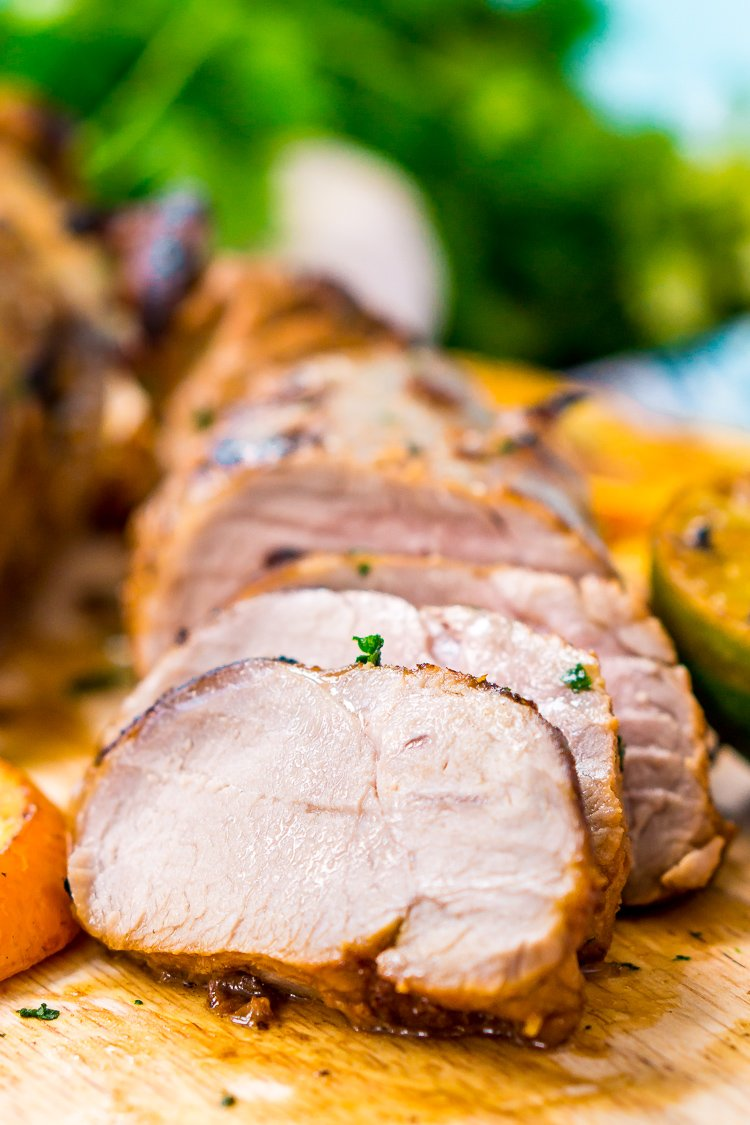 Cuban Mojo Pork is a delicious and easy pork tenderloin recipe made with freshly squeezed orange and lime juices, crushed garlic, minced cilantro, cumin, salt, and pepper.