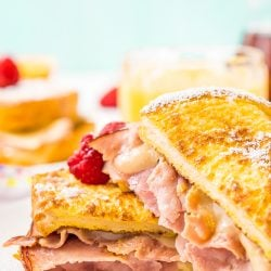 The Monte Cristo Sandwich is a breakfast twist on a classic ham and cheese. Tender slices of deli ham are sandwiched between two pieces of French toast and melty cheese for an addictive dish you'll want to make over and over again!