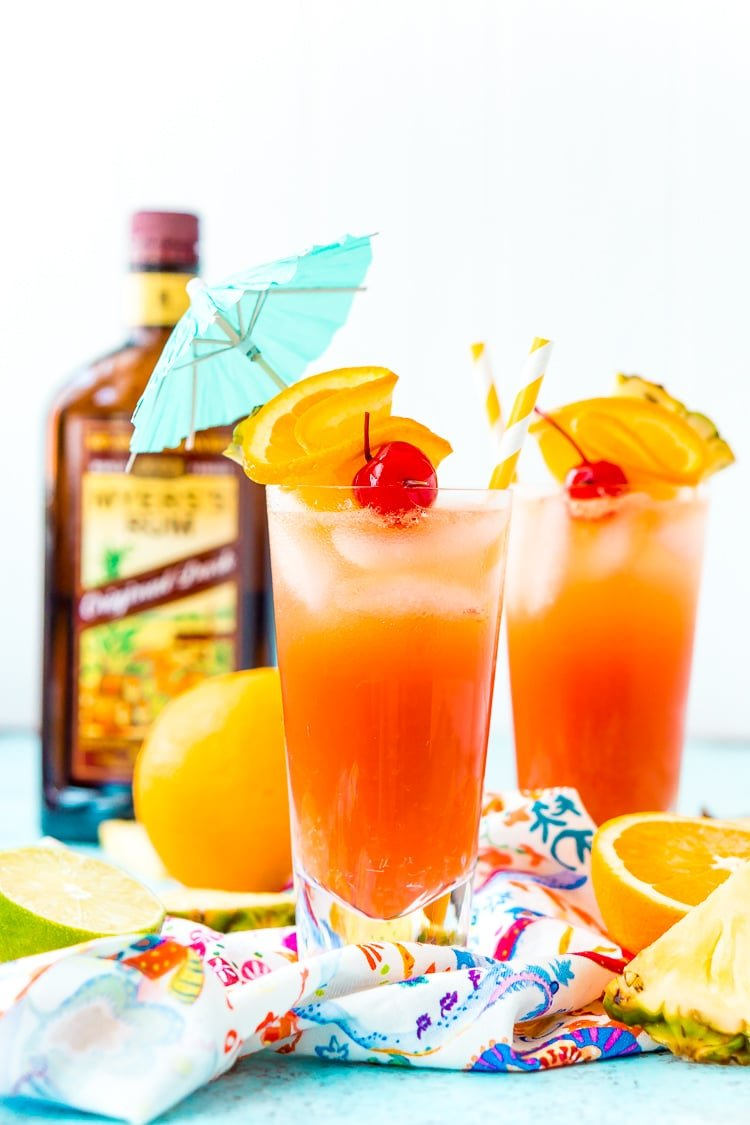 How To Make Planter's Punch - Planter's Punch is a fruity cocktail that's spiked with rum. Made with orange and pineapple juices, a splash of lime, grenadine, and dark or spiced rum, this tropical mixed drink is dangerously delicious!