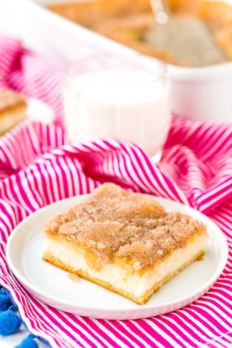 How To Make Sopapilla Cheesecake with crescent roll dough, cream cheese, sugar, butter, cinnamon, vanilla, and honey.