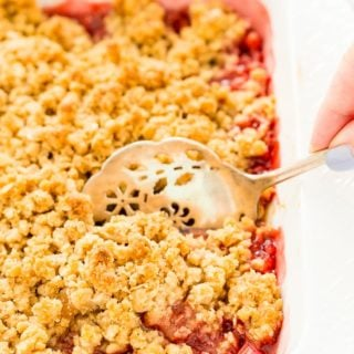 This Strawberry Rhubarb Crisp is an old-fashioned, simple, sweet, and tart summer dessert with a deliciously buttery and crispy crumble topping made from oatmeal and brown sugar.