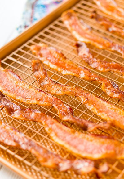 Baking Bacon in the oven is an easy method for cooking perfect bacon, the best part is, no mess! Enjoy the bacon immediately or save for other recipes!