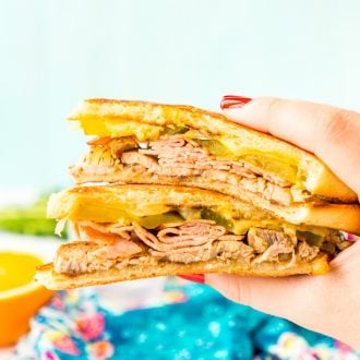 This Cuban Sandwich is loaded with smoked ham, swiss cheese, mojo pork, mustard, and pickles, and then grilled to melty perfection!