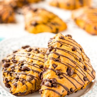 Pumpkin Scones are the sophisticated way to enjoy pumpkin and spice this season! This simple recipe calls for dark and semi-sweet chocolate chips so you can indulge your chocolate cravings and get your pumpkin fix morning, noon, or night.