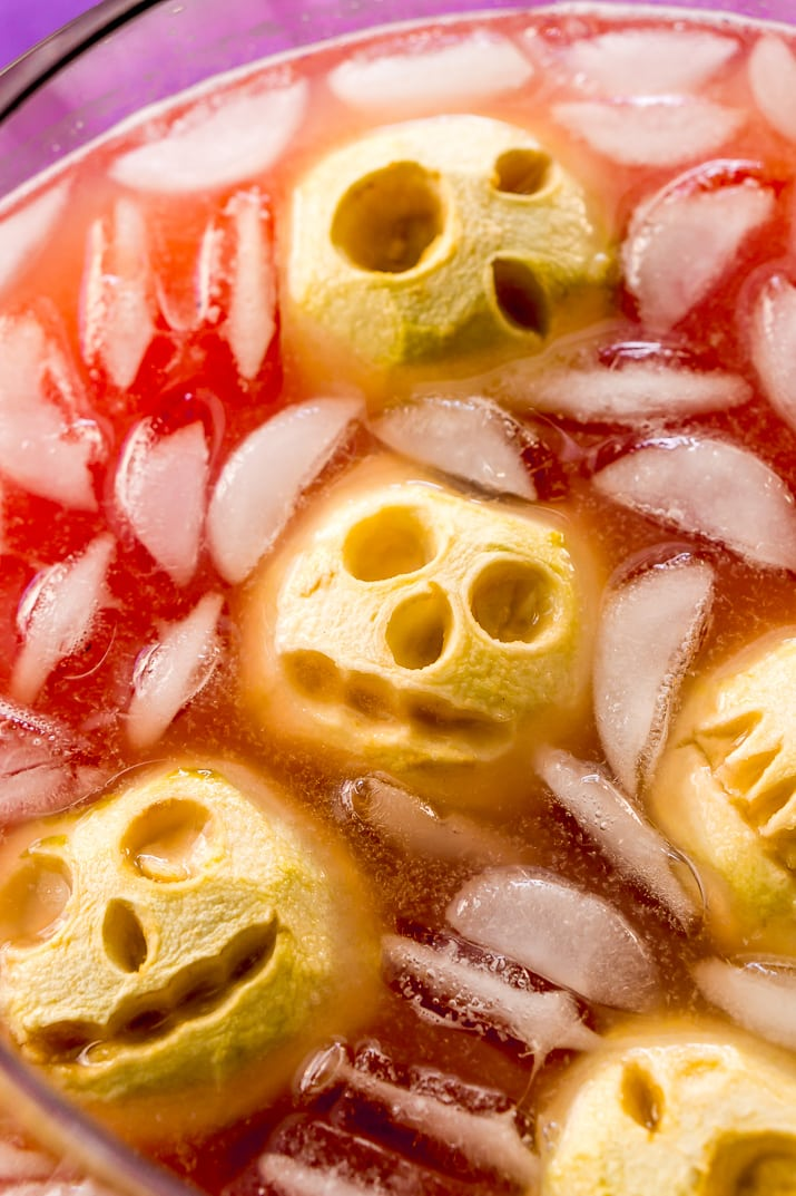 "Shrunken Head Party Punch doubles as a delicious drink and a creepy conversation piece! Made with fruit juices, lemon-lime soda, and a splash of grenadine, the best part of this beverage is the floating ""shrunken heads"" which are made with baked apples!"