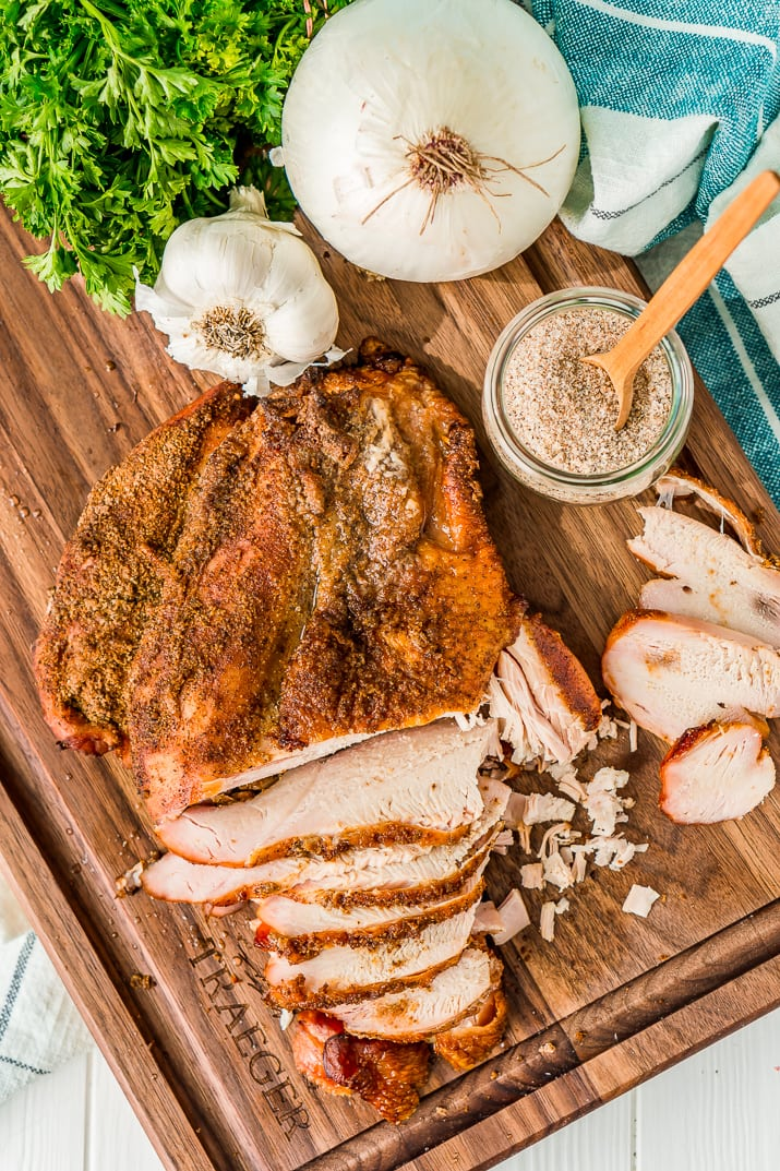 This Smoked Turkey Breast is made with a warm and spicy dry rub that adds tons of flavor to the tender and juicy meat.
