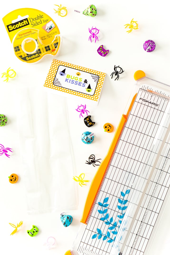 Planning a kid-friendly Halloween party or a family craft day? This adorable Bugs & Kisses Halloween Printable is perfect for preparing little bags of treats … and it's free!