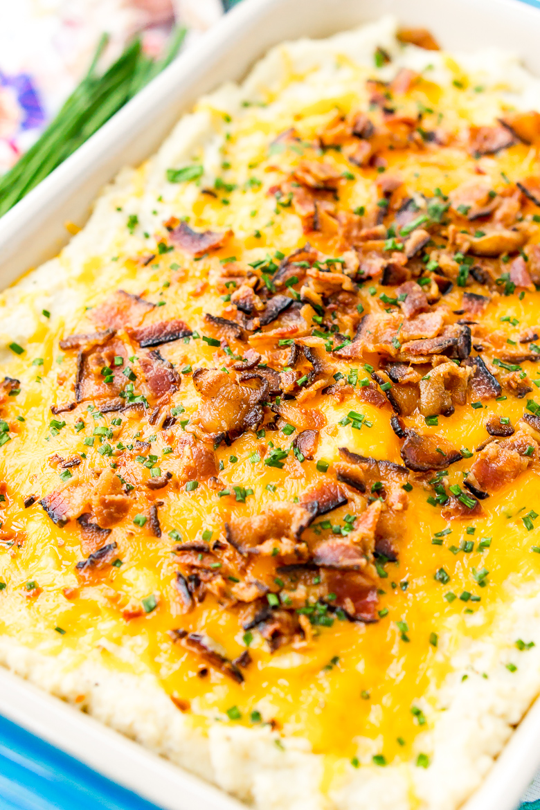 Loaded Cauliflower Casserole is an easy and delicious low carb and keto-friendly side dish loaded with bacon, cheddar cheese, sour cream, garlic, and more!