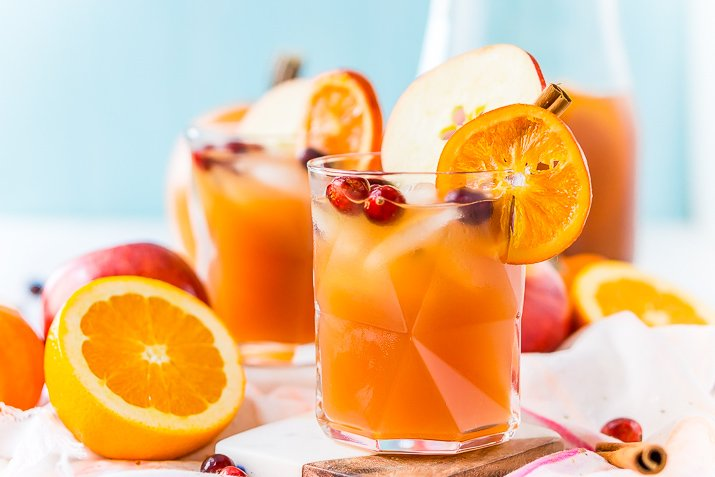 This Thanksgiving Punch made with apple cider, whiskey, fruit juice, brandy, and soda packs the delicious flavors of fall and winter in one delicious holiday drink recipe!