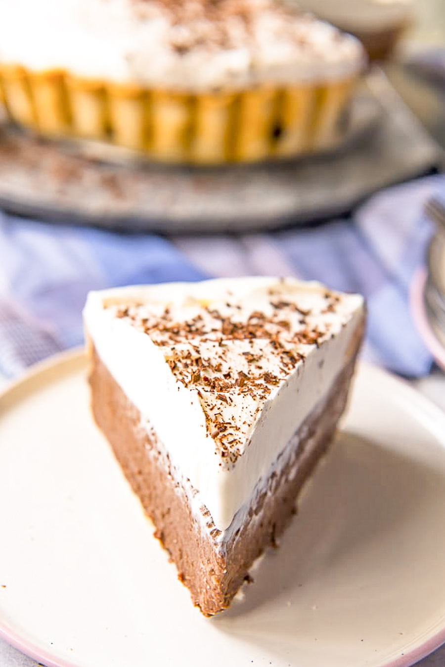 Creamy and luscious beyond belief, this is the ultimate old-fashioned Chocolate Cream Pie recipe! Whether you make your own crust or take it easy with a store-bought one, the rich filling and fluffy whipped cream on top will make this a dessert worth repeating.