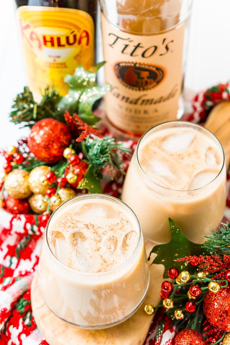 This Eggnog White Russian is a fun holiday twist on the classic vodka cocktail! Made with eggnog, coffee liqueur, vodka, and a dash of nutmeg!