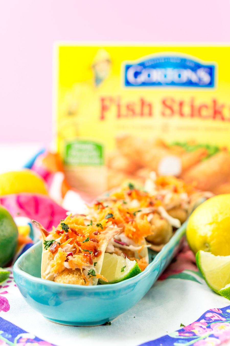 These Fish Sticks Wonton Tacos are an easy appetizer recipe perfect for get-togethers. Each mini taco is made with Crunchy Breaded Fish Sticks, crunchy slaw, and an Asian-inspired sauce.