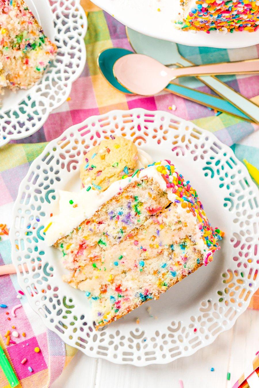 This Funfetti Sugar Cookie Dough Cake is an over the top cake made with two layers of white almond cake loaded with sprinkles and a layer of edible sugar cookie dough, then topped with classic vanilla buttercream!